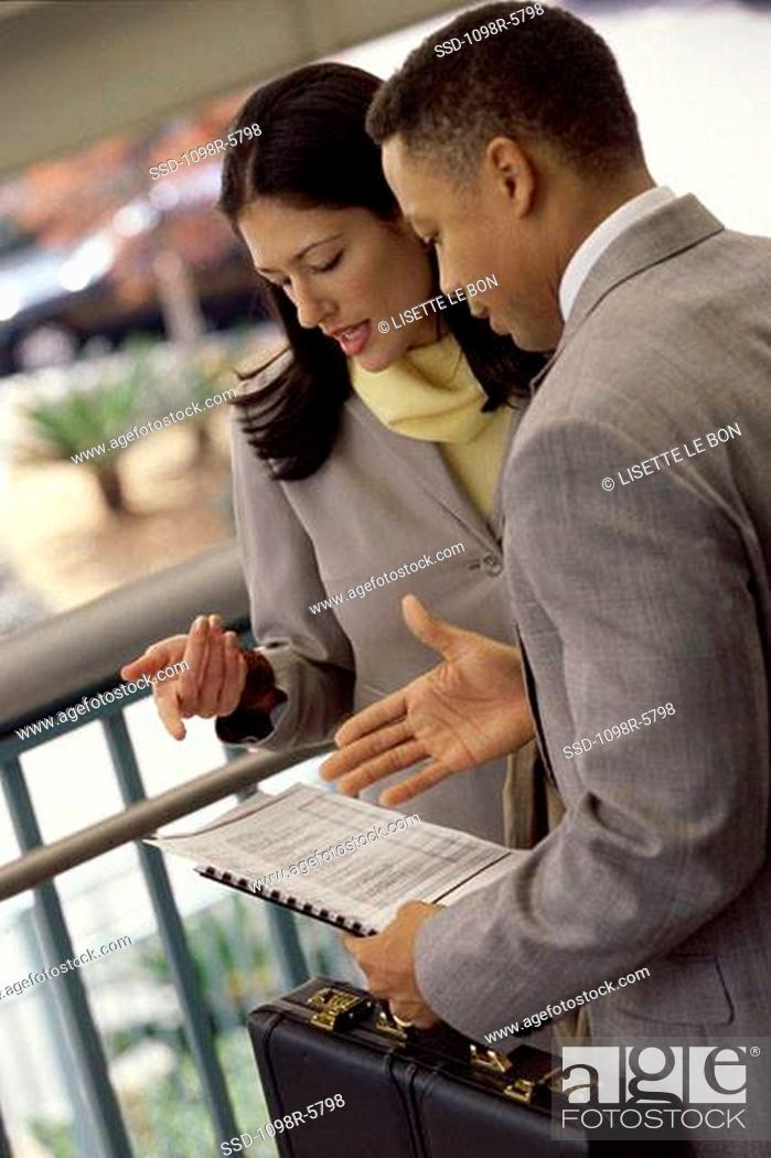 Stock Photo: Businessman and a businesswoman talking.