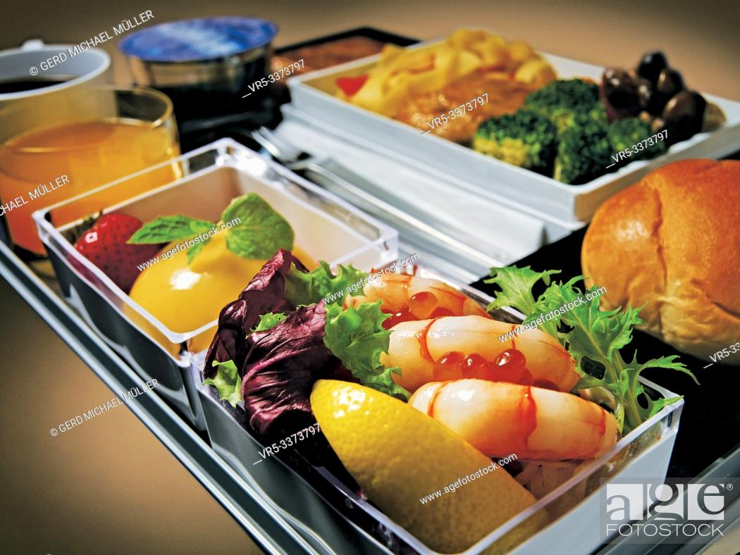 Stock Photo: A 380 Inflight Service from Singapore Airlines: a delicious Shrimp salad, brokoli, meat and fruits meal.