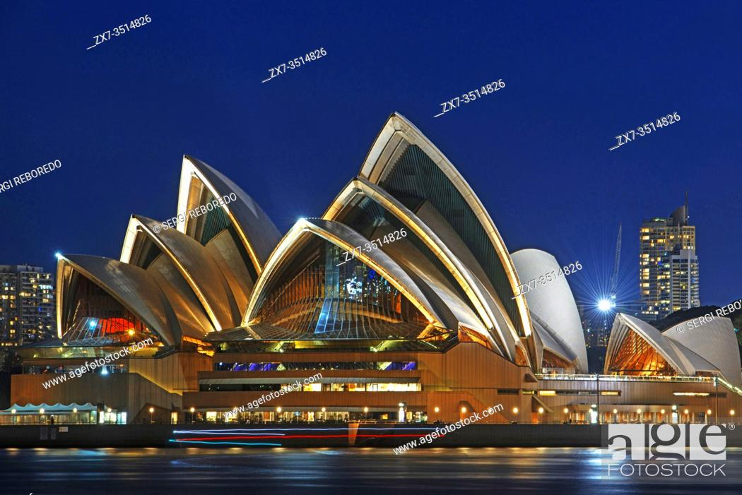 Stock Photo: Opera House and city CBD at sunset. Illuminated arch of the bridge reflecting in blurred waters Sydney, New South Wales, Australia.