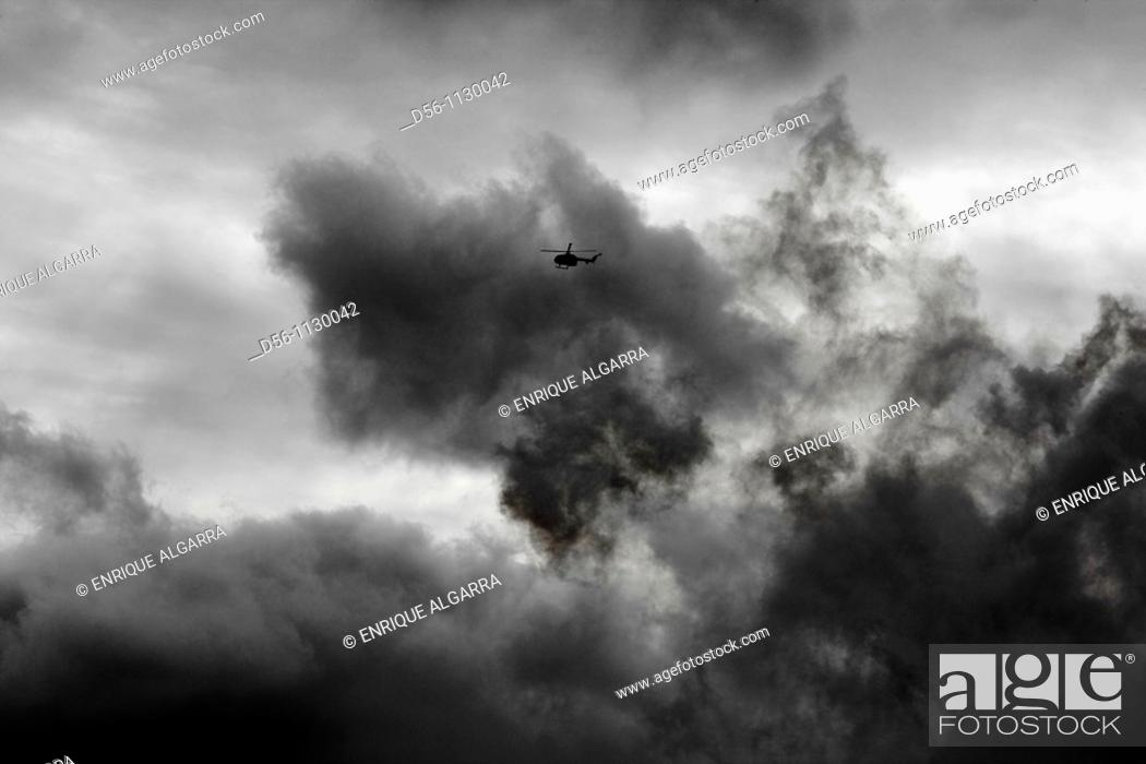 Stock Photo: Helicopter flying during 'Mascletà' fire works, 'Fallas' festival. Valencia. Spain.