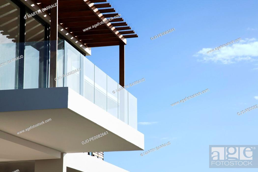 Stock Photo: Glass balcony on modern house.