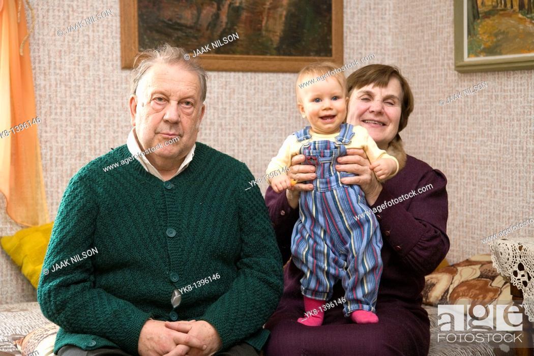 Photo de stock: Happy Caucasian Senior Grandparents Holding Kid Baby.