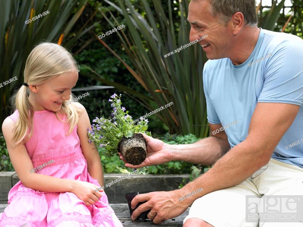 Stock Photo: Father and daughter gardening.