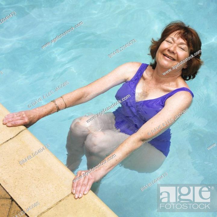 Stock Photo: Senior Hispanic woman in swimming pool.