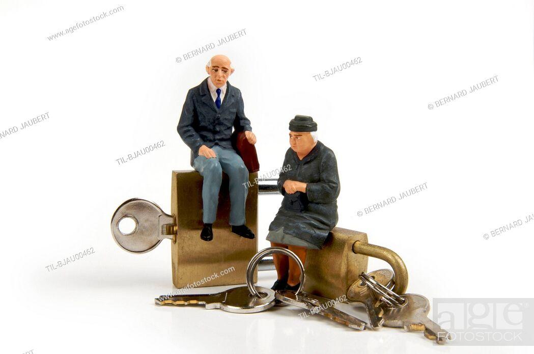 Stock Photo: Model of elderly couple sitting on locks.