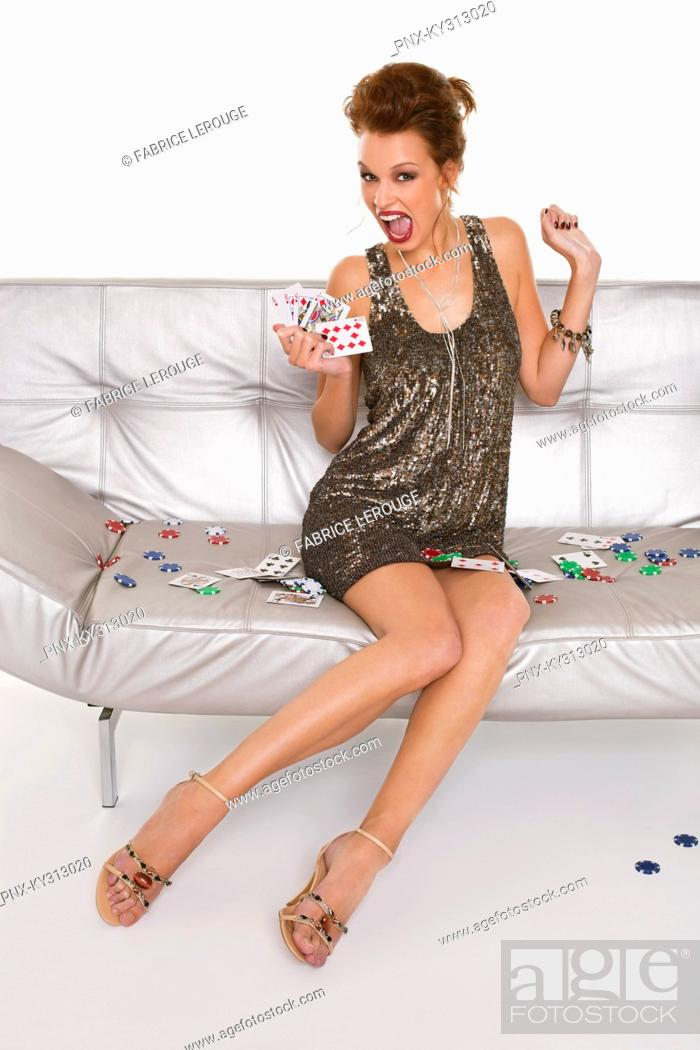 Stock Photo: Young happy woman in formalwear holding cards.