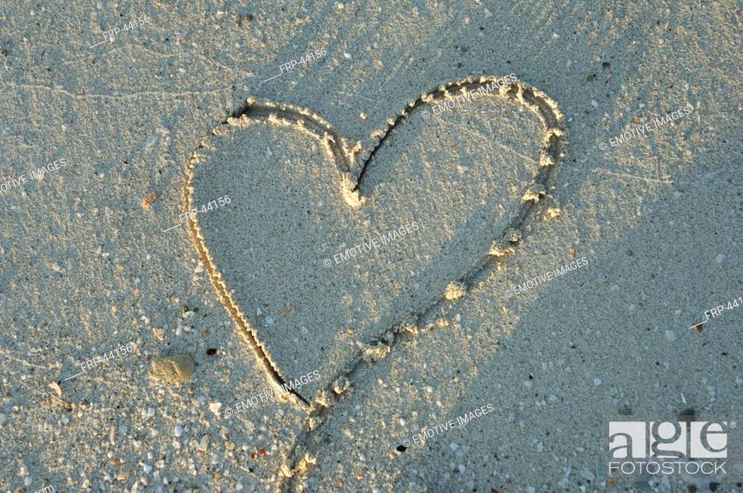 Stock Photo: Heart in the sand.