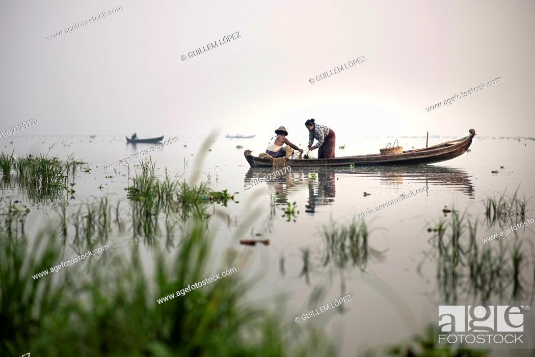 Stock Photo: Fishermen at work in the Taungthaman Lake , Amarapura, Myanmar.