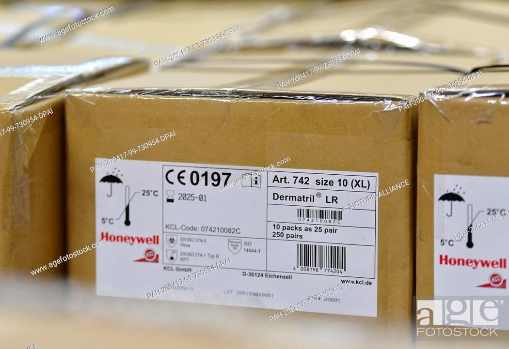 Stock Photo: 16 April 2020, Brandenburg, Großbeeren: A package from Honeywell with disposable Dermatril gloves is available from the logistics service provider Rhenus.