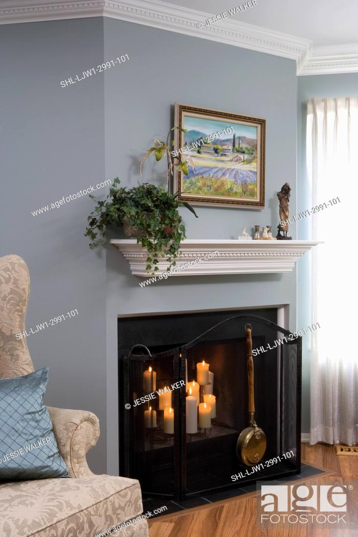 Stock Photo Fireplaces Pale Blue Walls White Painted Trim Dentil Molding On Mantel And Crown Candles In Fireplace