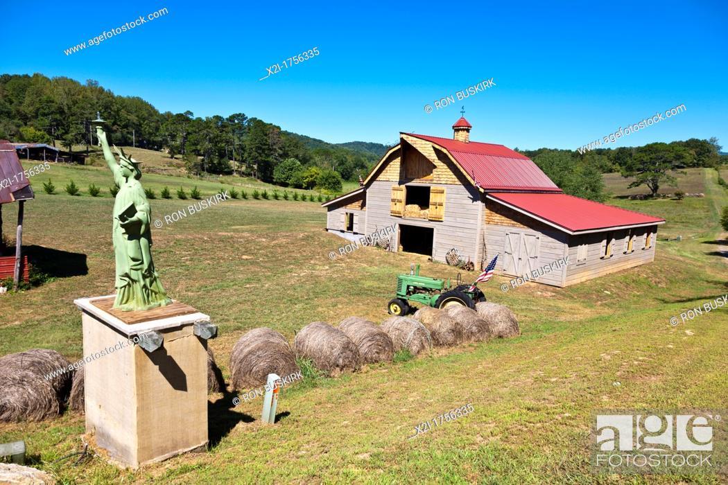 Stock Photo: A small replica of the Statue of Liberty on a rural farm near Franklin, South Carolina.