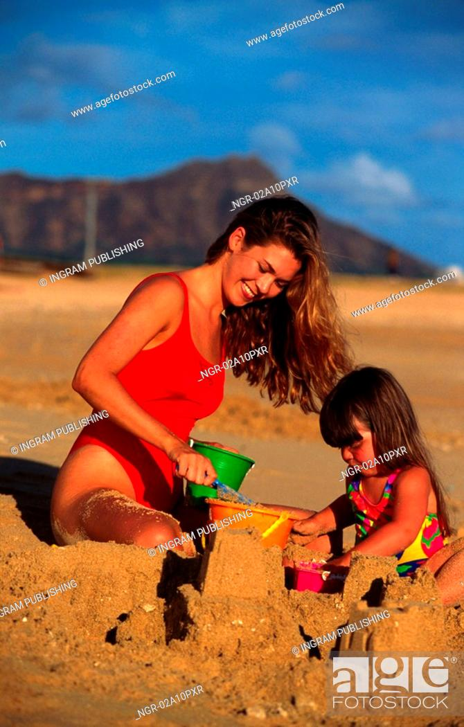 Stock Photo: mother and daughter at the beach.