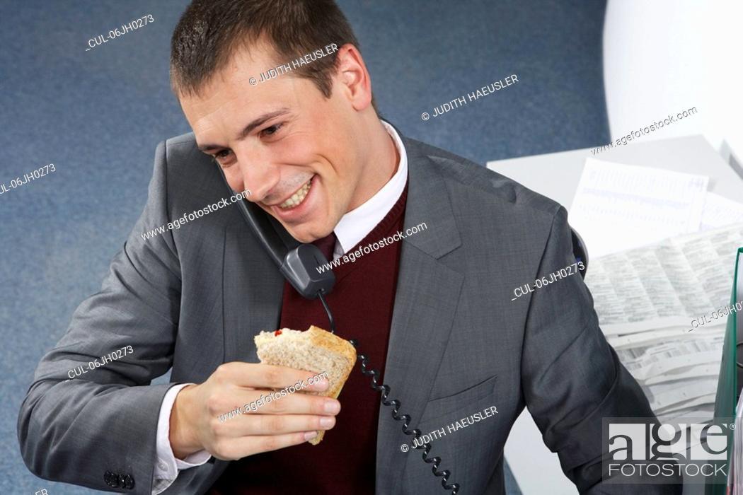 Stock Photo: Businessman on phone, smiling.