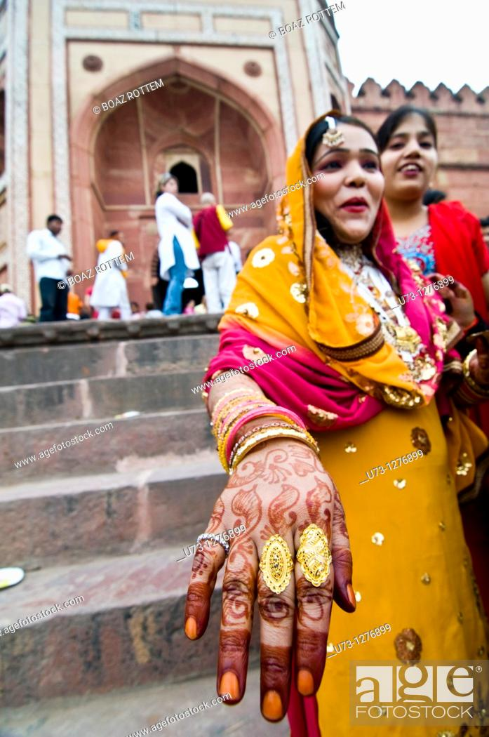 Stock Photo: Showing off her Henna and rings.