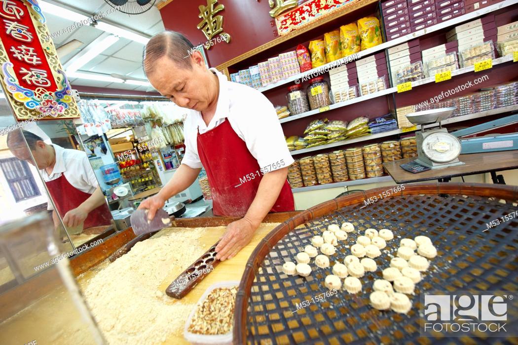 Stock Photo: A man making traditional almond biscuits in a workshop located in Rua Da Felicidade  Macau  China.