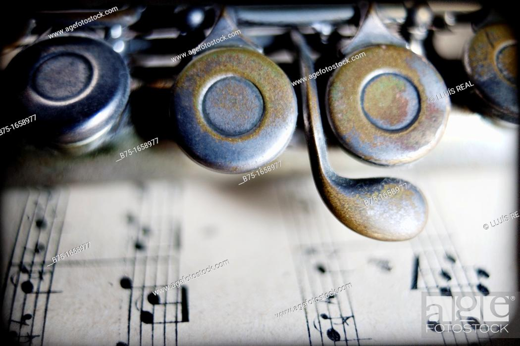 Stock Photo: Music, musical instrument, flute, score.