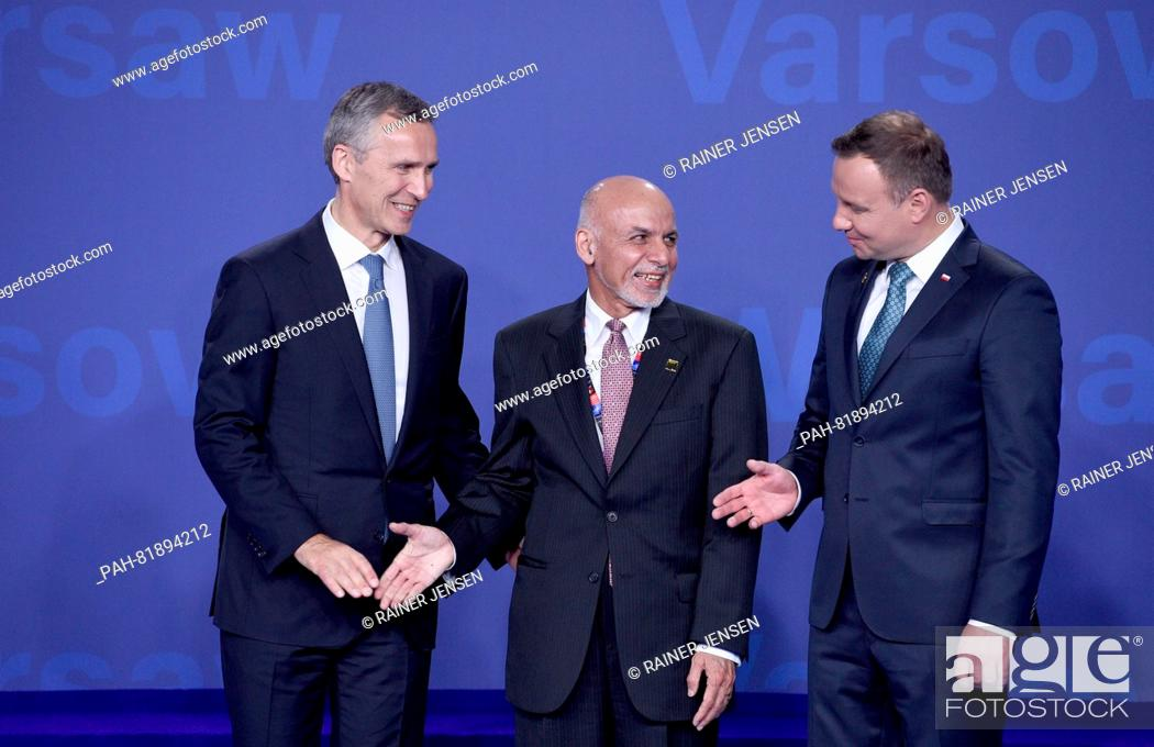 Stock Photo: Afghan President Ashraf Ghani (c) being welcomed by Nato General Secretary Jens Stoltenberg (l)and Polish President Andrzej Duda at the national stadium in.