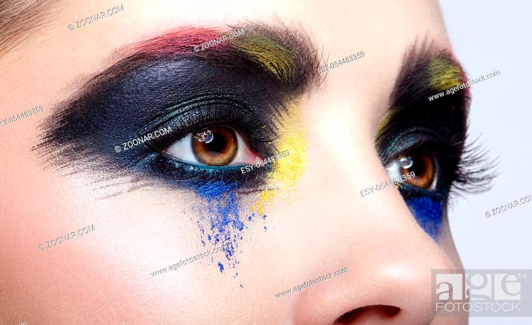Stock Photo: Close-up macro portrait of beautiful woman eye zone make up. Female eye with unusual artistic painting makeup.