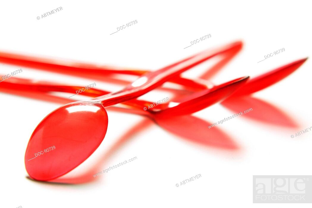 Imagen: three red joghurt spoons on white base.