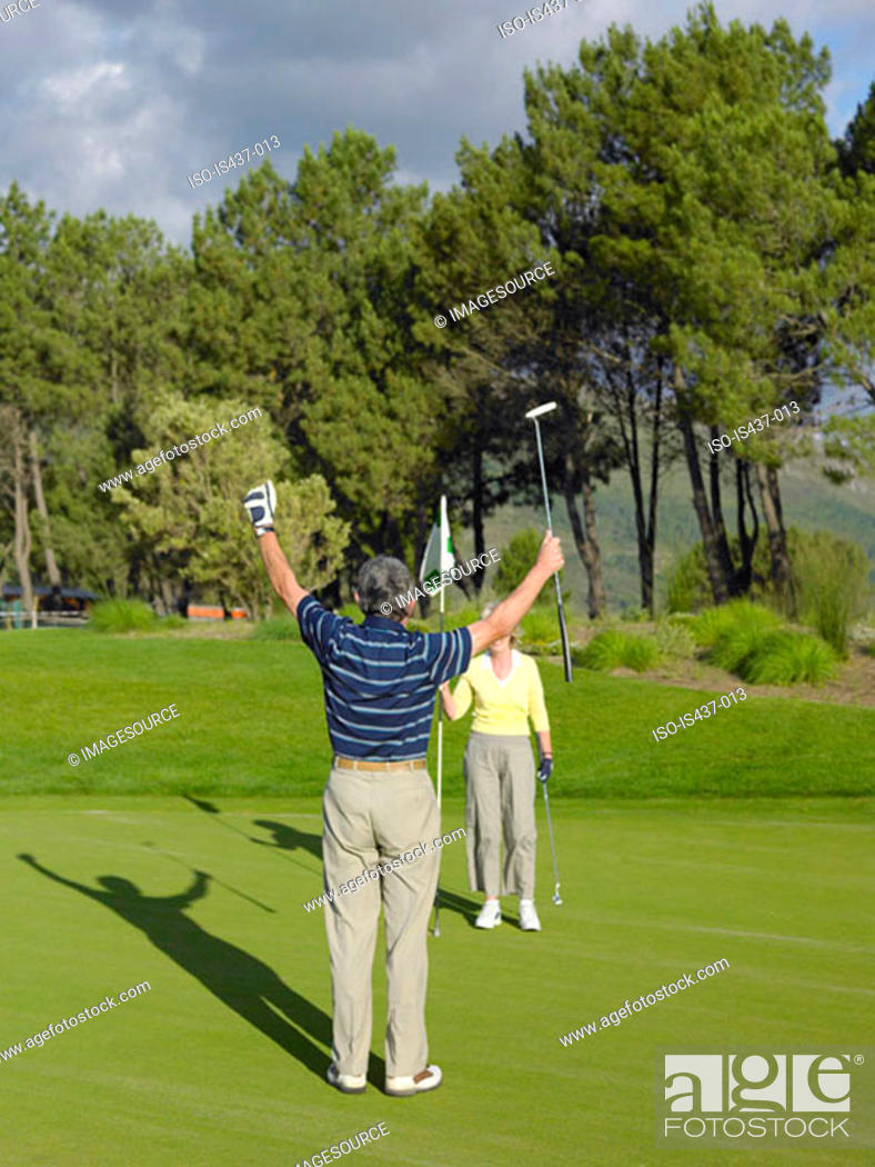 Stock Photo: Couple playing golf.