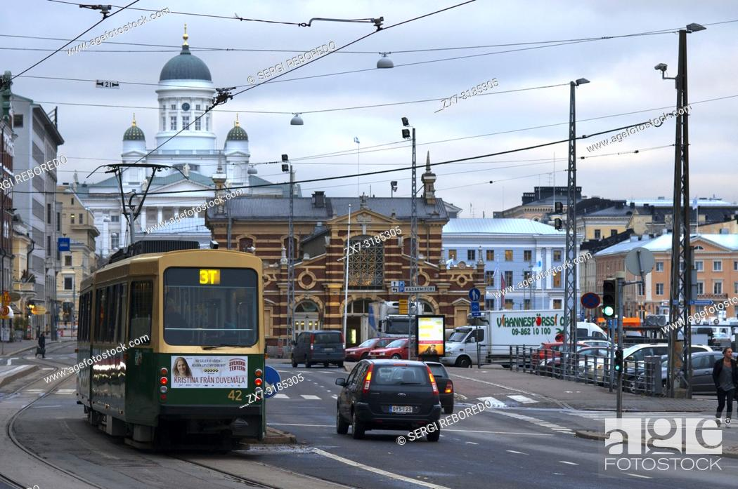 Stock Photo: General view of the Helsinki city with the tram, market, and the Senaatintori Lutheran Cathedral from the Eteläranta street.