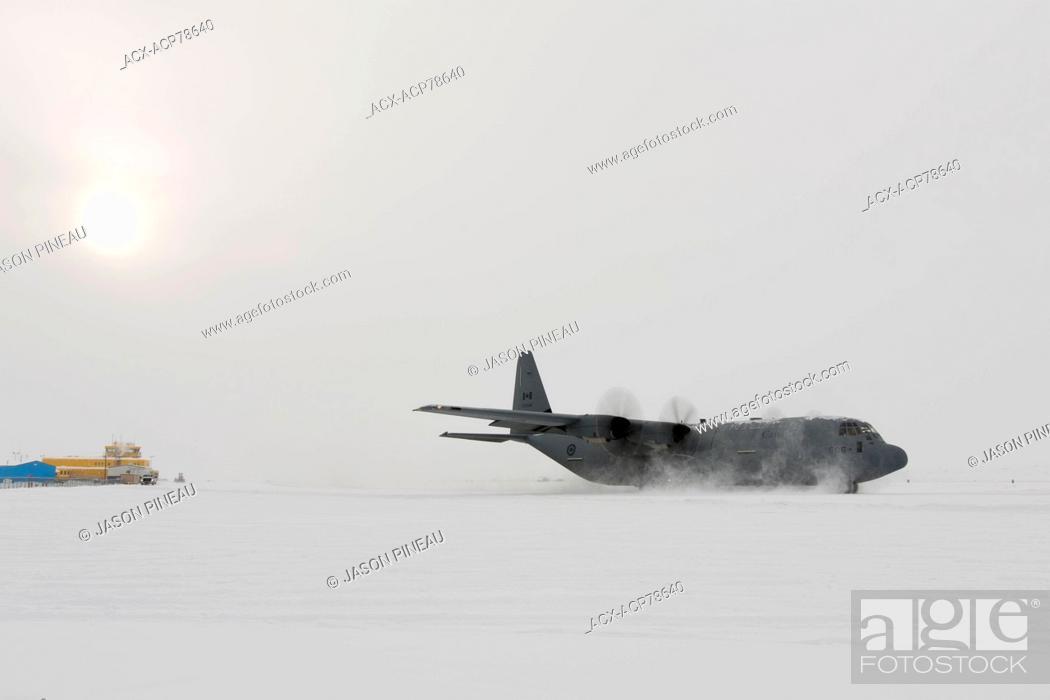 Stock Photo: A Canadian Air Force Lockheed Hercules aircraft in Iqaluit, Nunavut, Canada.