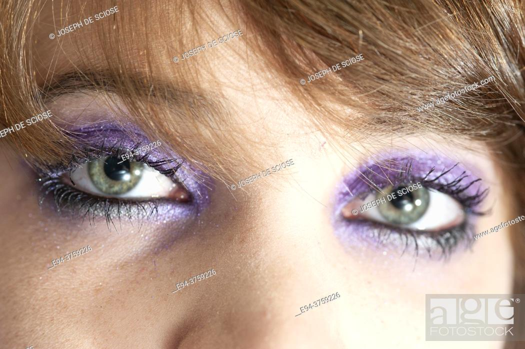 Stock Photo: Close-up of eyes of and 18 year old brunette woman wearing.