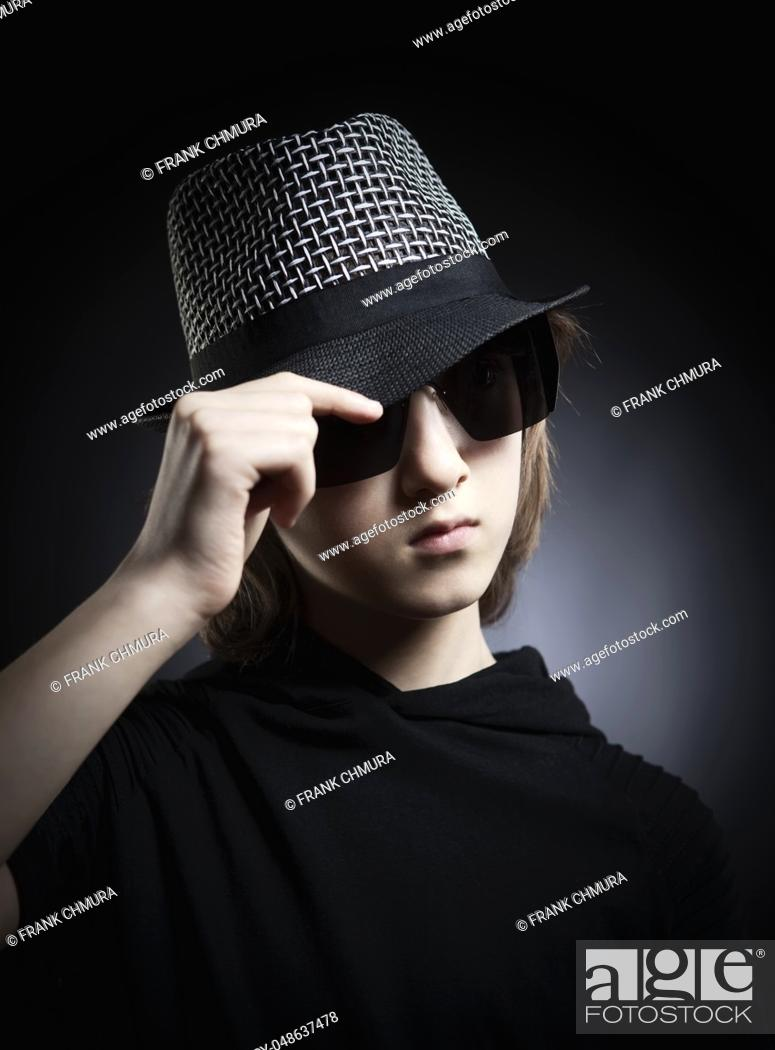 Imagen: Portrait of a Boy with Blond Hair in Hat and Black Top.