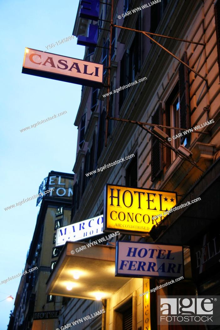 Stock Photo: hotel signs at night in the termini district rome italy.