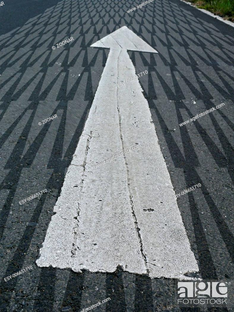 Stock Photo: Arrow marked on a highway to show direction.