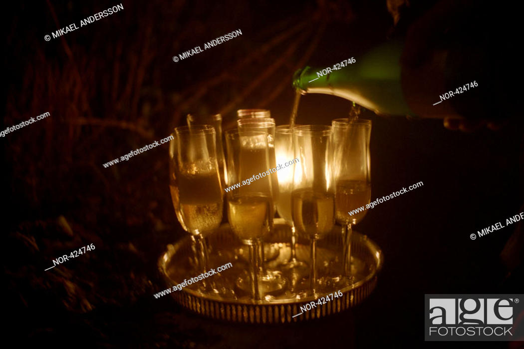 Stock Photo: Pouring champagne in glasses  New Year's celebration  Sweden.