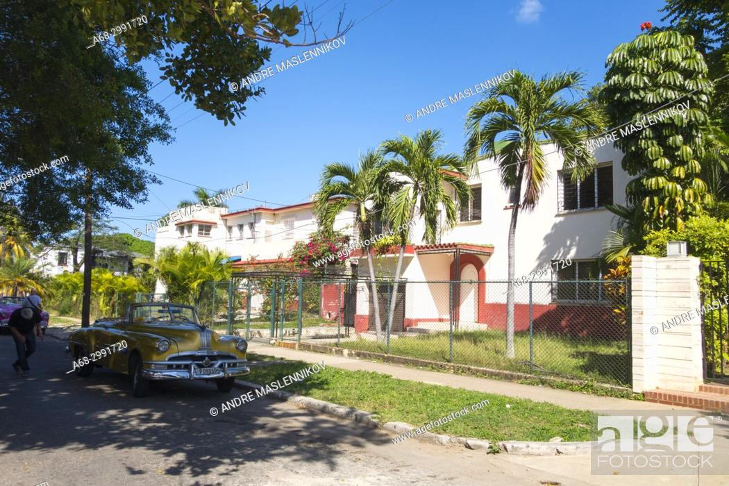Stock Photo: The street Calle 18 in the wealthy west part of Havana. Cuba.