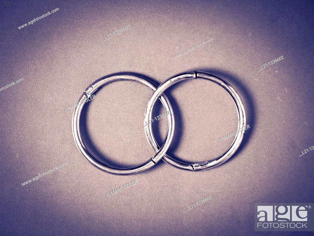 Stock Photo: Two steel rings. Symbol of union.