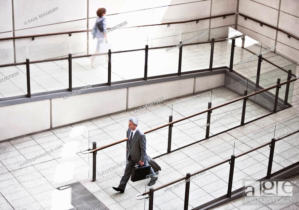 Stock Photo: Business people walking on ramp.