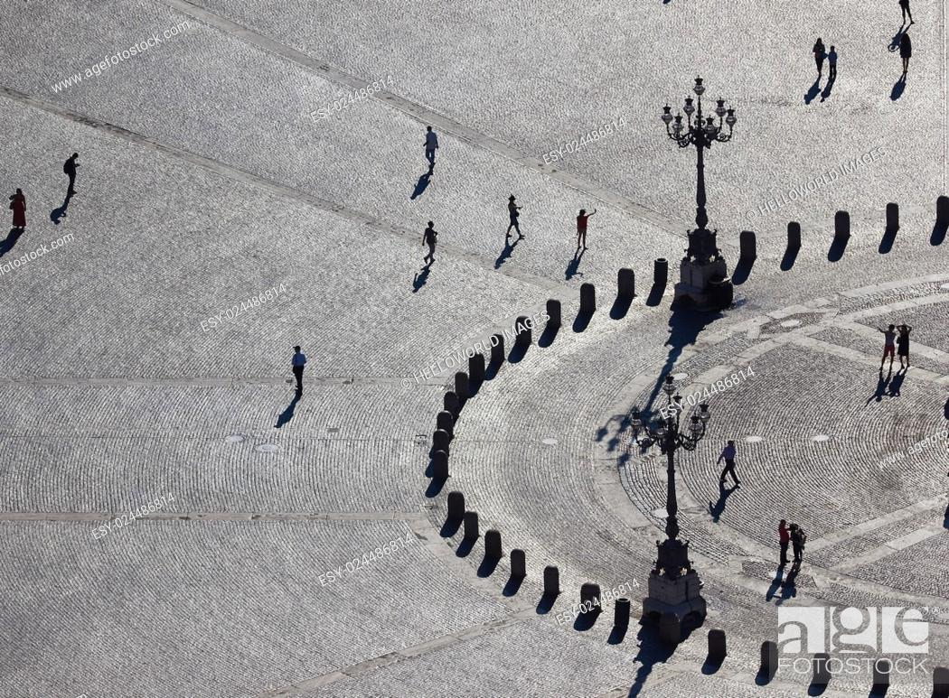 Stock Photo: Tourists and street lamps in cobbled Piazza San Pietro, Rome, Italy, Europe.