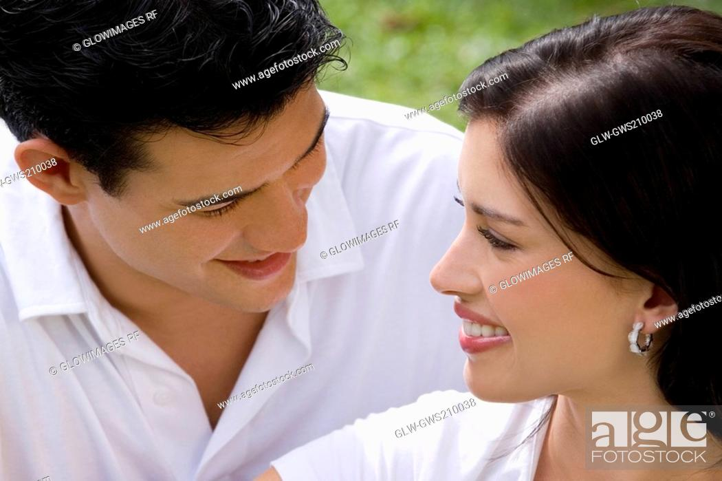 Stock Photo: Close-up of a young couple looking at each other and smiling.
