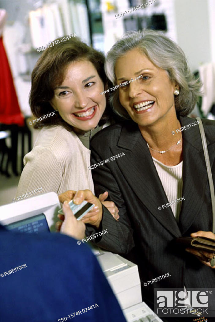 Stock Photo: Mother and her daughter shopping in a store.