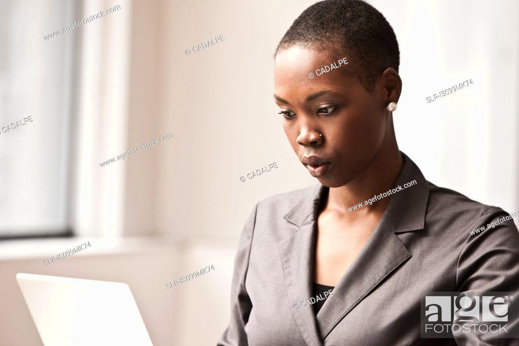 Stock Photo: Young businesswoman working.