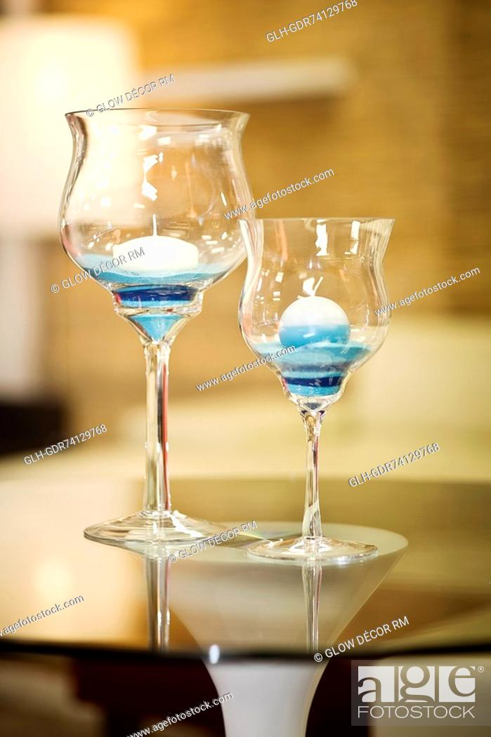 Photo de stock: Candles in stem glasses.