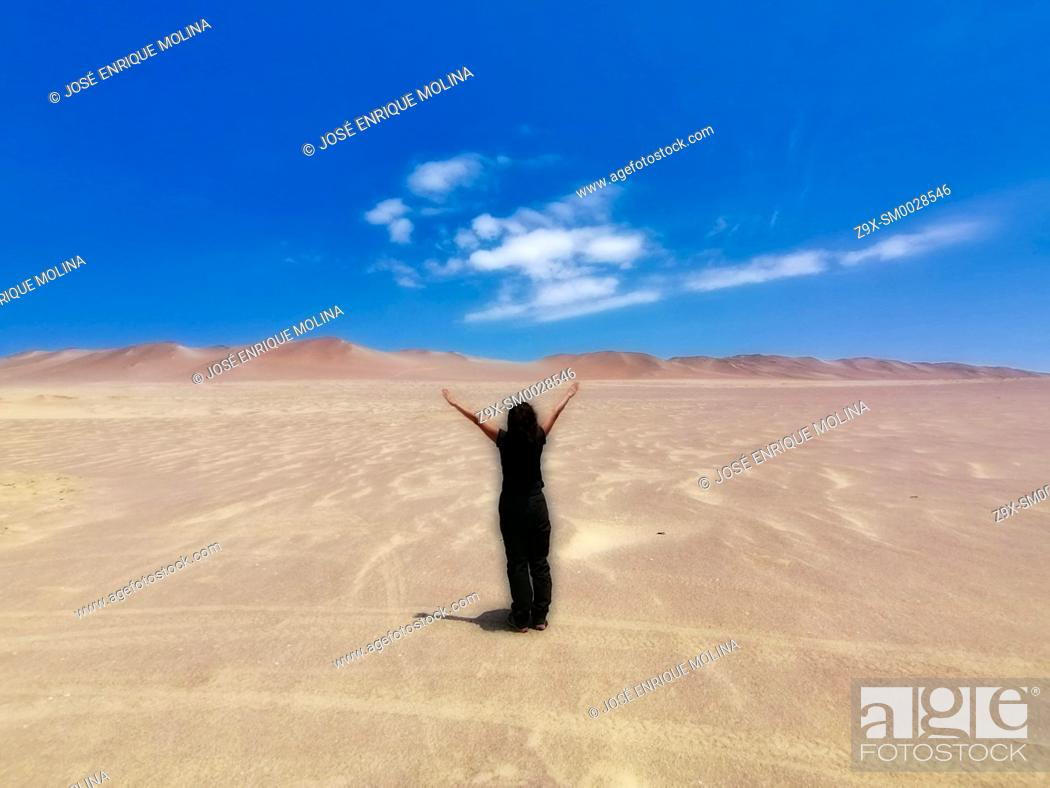 Stock Photo: National Reserve of Paracas, woman in the desert, Ica department, Perú. South America.