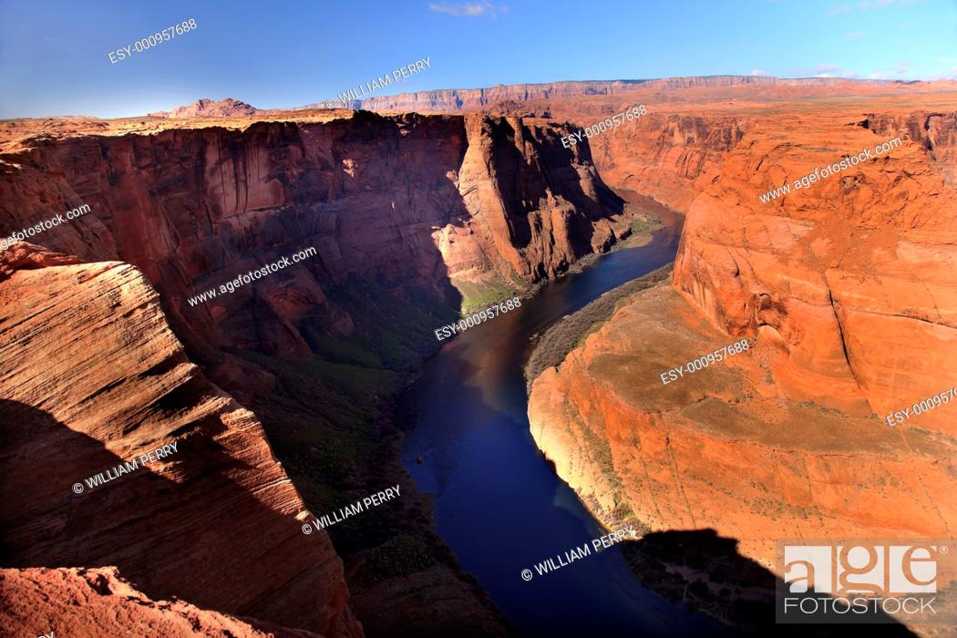 Stock Photo: Horseshoe Bend Orange Glen Canyon Overlook Blue Colorado River Entrenched Meander Page Arizona.