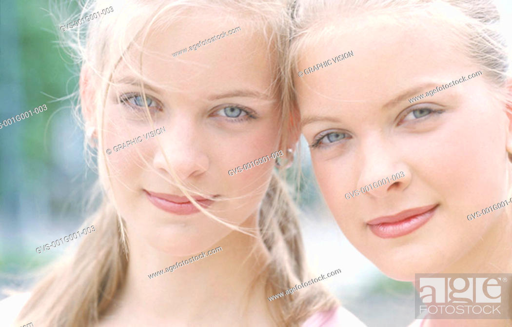 Stock Photo: Portrait of Two Young Women Outdoors.