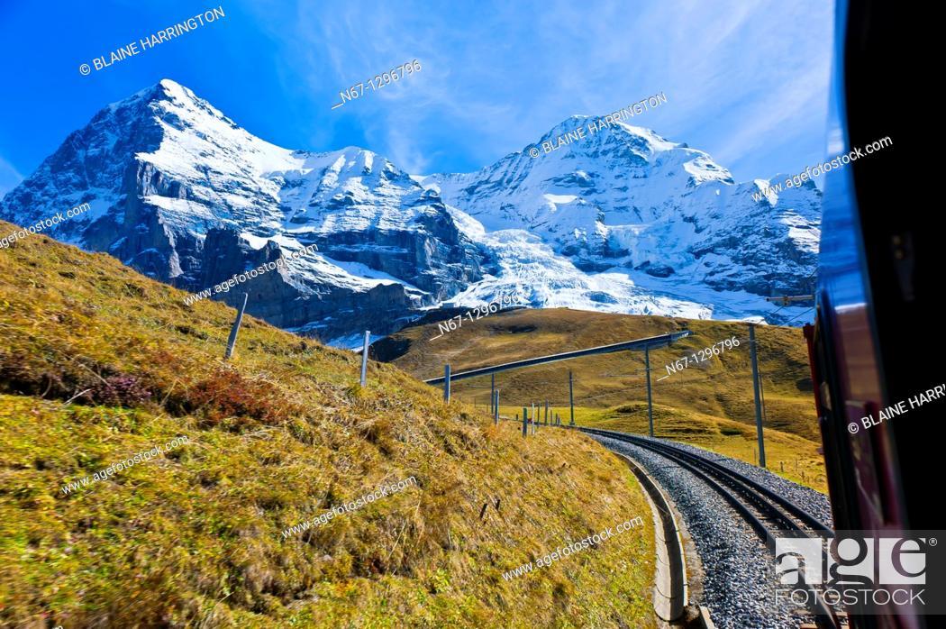 Stock Photo: Jungfrau Railway train climbing from Kleine Scheidegg to Eigergletscher, Swiss Alps, Canton Bern, Switzerland.