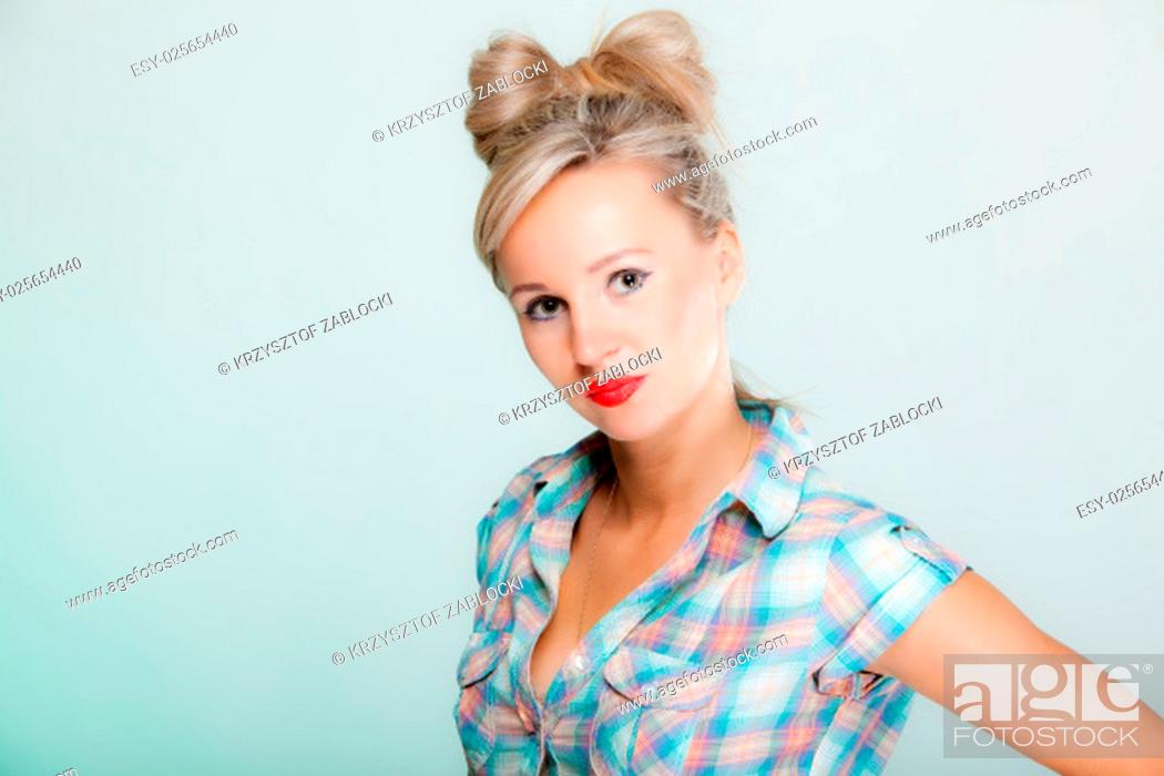 Stock Photo: portrait beautiful young blonde woman in pin-up style vintage retro styling on green background.