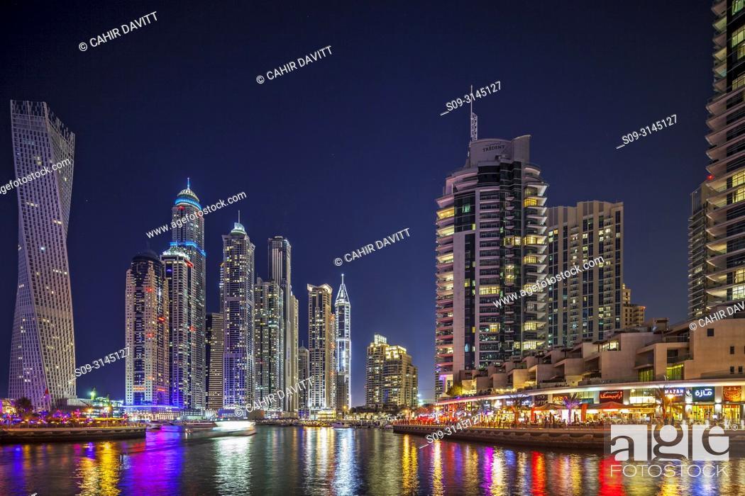 Stock Photo: Dubai Marina at twilight with the Cayan Tower (Infinity Tower), the Dubai Marriott Harbour Hotel and Suites and various residential towers, Dubai Marina, Dubai.