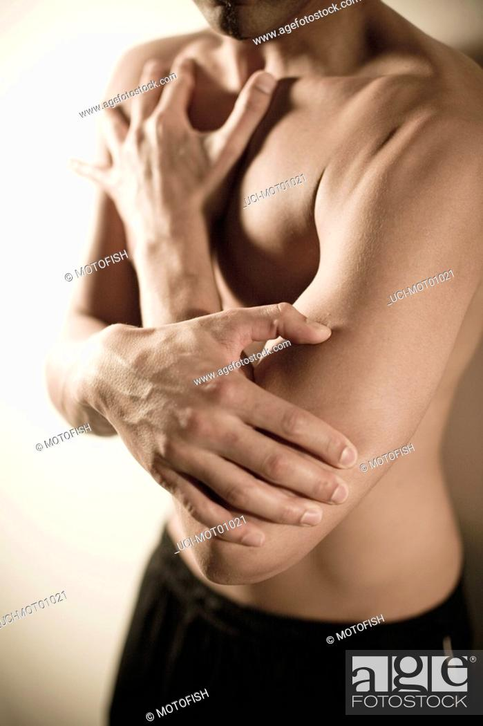 Stock Photo: Bare-chested man with hand on elbow.