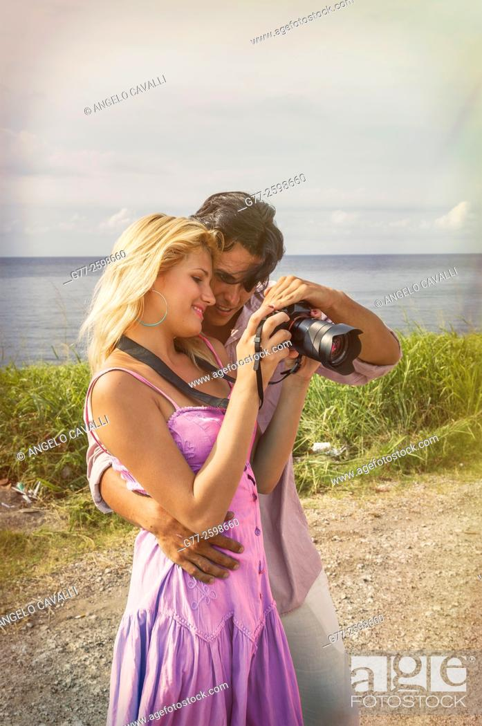 Stock Photo: Miami Beach. Florida. Usa. Couple watching picture in the camera.