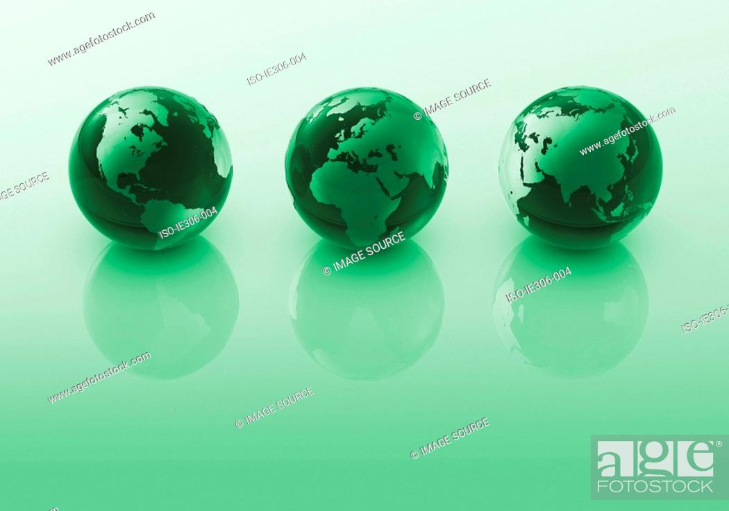 Stock Photo: Three green globes.