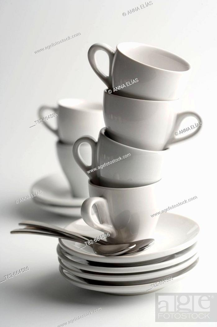 Stock Photo: Cups, saucers and spoons.
