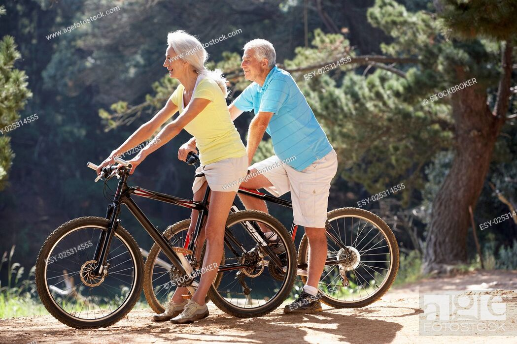 Stock Photo: Senior couple on country bike ride.